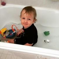 Back into the bath 10secs after dressing him.